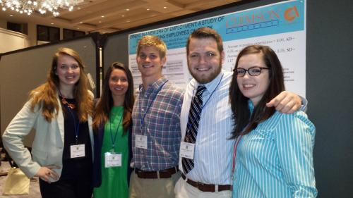 Research assistants presenting at Work, Stress, and Health